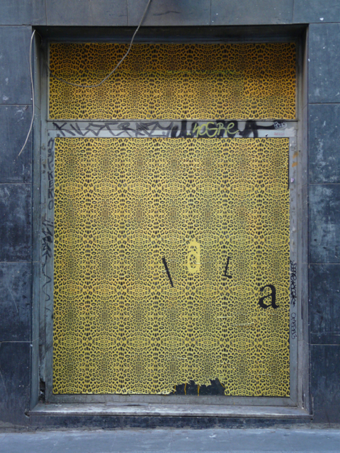 Places in Barcelona covered in yellow wallpaper street art